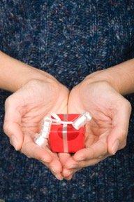 hand-holding-tiny-gift